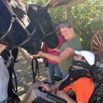 Jamie White and his mother Deb Kappler meet Percherons Peggy and Debbie at Rush Ranch